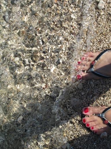 Soaking my feet on the Zlatni Rat beach, Croatia, 2014